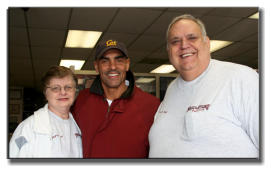 The Neal's with former Chiefs Coach Herman Edwards
